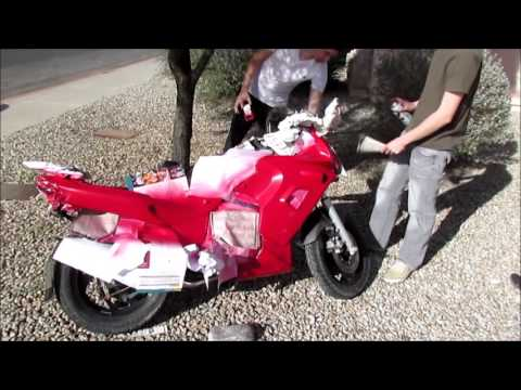 Spray painting a motorcycle