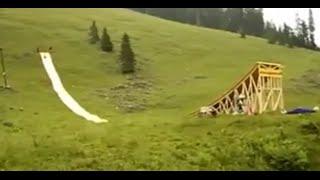 Man slides off huge ramp and lands in paddling pool !