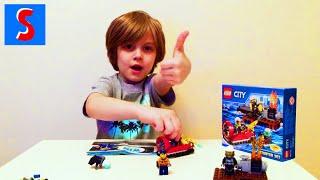 Слава распаковывает набор Lego 60106 пожарный катер. Slava unpacking Lego Fire Starte set(Слава распаковывает набор Lego 60106 пожарный катер. Slava unpacking Lego Fire Starte set. Также распакован минифигурки Lego 16..., 2016-03-28T04:22:25.000Z)