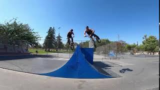 Guys Do A Duo Backflip Jump On Bmx Ramp