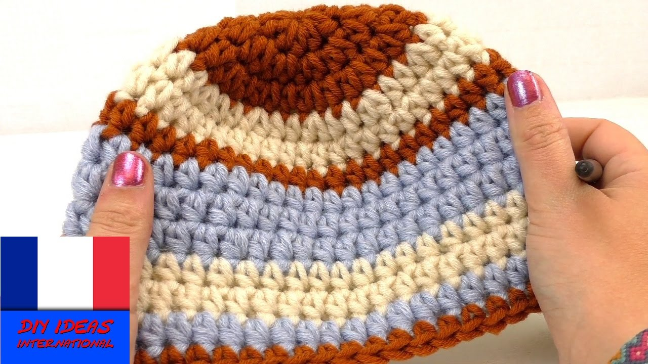 adfb7bad608 Crocheter un bonnet pour enfant DIY pour l u0027hiver Bonnet avec 3  couleurs pour rester au chaud