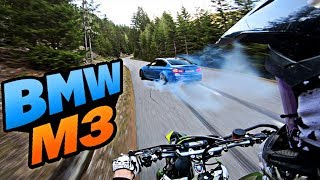 Chasing tuned BMW M3 on a mountain road