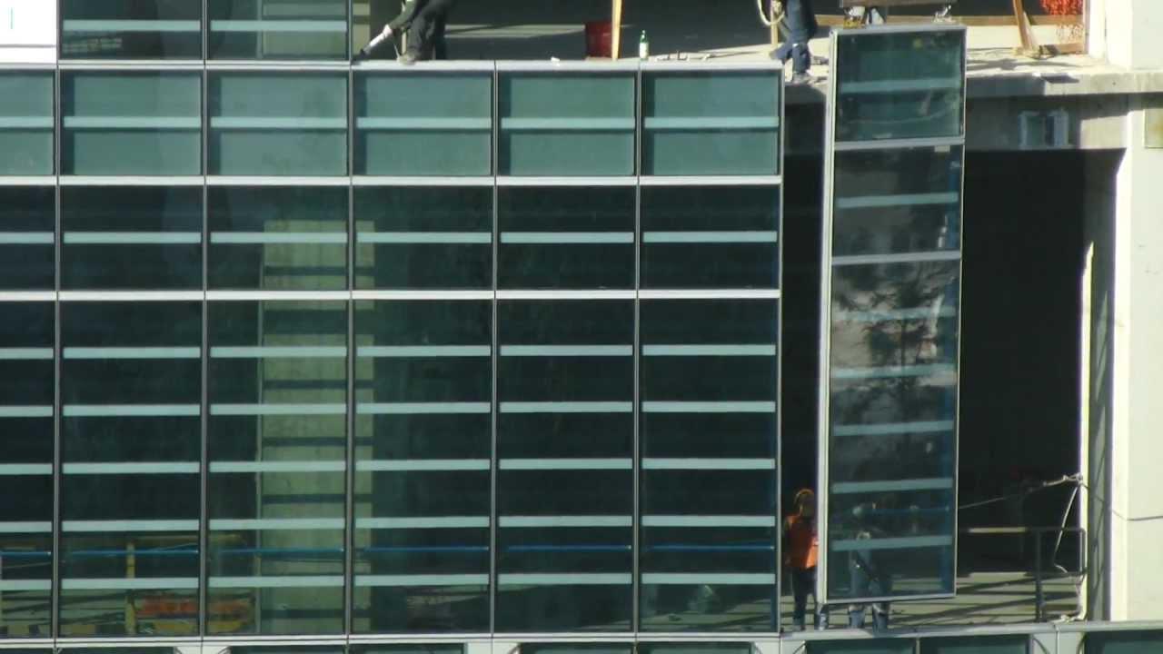 Costanera center instalaci n vidrios exteriores muro for Cortinas exteriores