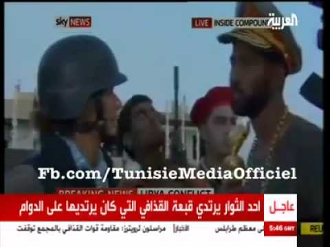 Freedom Fighter Wears Gaddafi's Hat, Sceptre, and Gold Chain