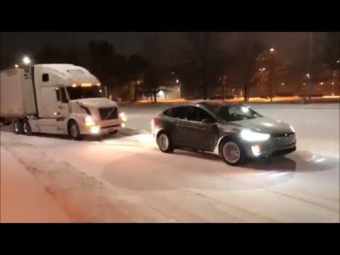 Tesla Model X pulling loaded Truck in Snow