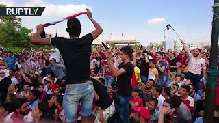 Fans with flags: Syrian soccer fans rejoice as Damascus draws 1-1 in match with Aussie team