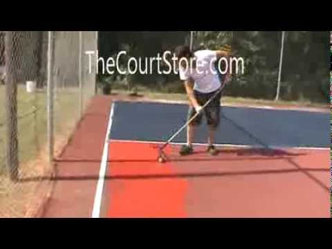 Rolling On Tennis And Basketball Court Paint
