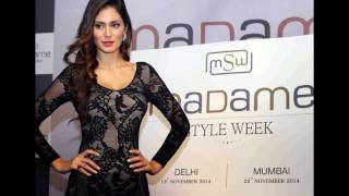 Bruna Abdullah Showcasing Her Sexy Long Legs In a Black Net Short Dress At Madame Style Week