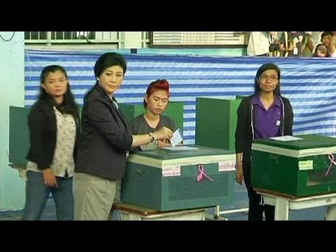 Divided Thailand votes but opposition threatens poll disruption