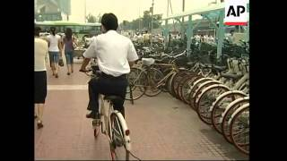 Restrictions on cars put Beijing commuters back on their bikes