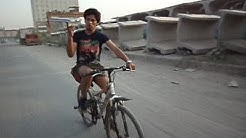 National Record - Farthest distance (4 km) riding bicycle while Spinning Book on Finger.
