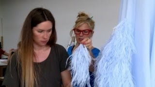 Traditional French feather-workers strut stuff on catwalk