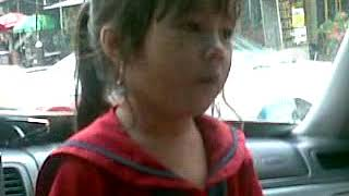 Cute kid sing a song and dance on the car