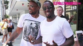 Diddy Poses With Paparazzi Wearing A Notorious B.I.G. Sean John Shirt At Avra In Beverly Hills