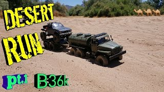 WPL B36k upgraded towing a C14k around in the desert.