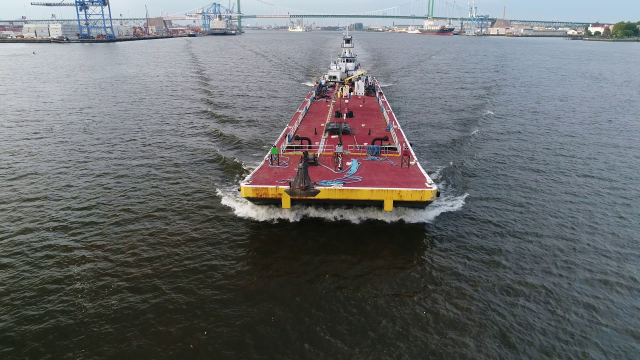 Aerial View Of Tug Boat Elk River Pushing A Barge Down Delaware River