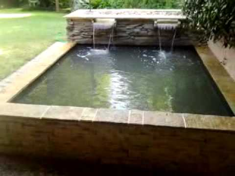 Contemporary koi pond with bog waterfall youtube for Contemporary koi pond design