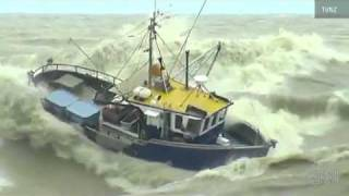 Breaking News-Boats battle waves at New Zealands port.
