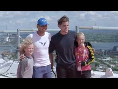 Rafael Nadal and Dominic Thiem play tennis at the top of Olympic Stadium in Montreal