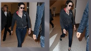 Kristen Stewart cut a casual figure as she hurried to catch a flight on Tuesday afternoon, after 'sh