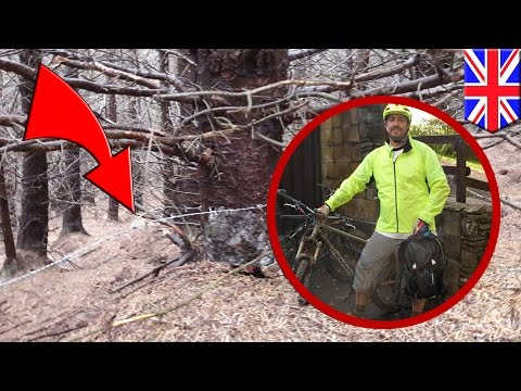 Mountain biker nearly beheaded by barbed wire booby trap strung across trail in Wales - TomoNews