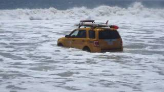 Car Gets Taken By Large Waves At Zuma Beach, California
