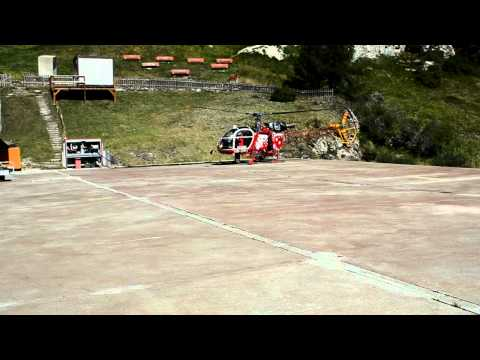 Helicopter landing at Heliport in Zermatt