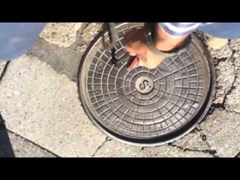Surveyor Manny shows kids how to dip a manhole!