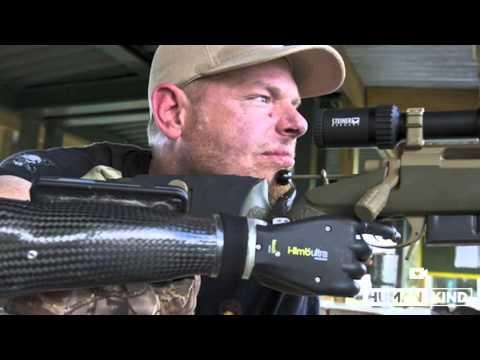 No hands? No problem. Marine shoots again with new gun