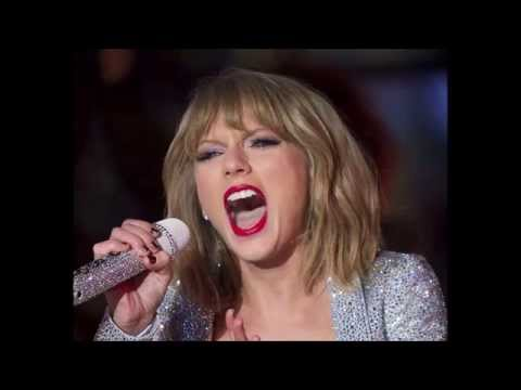 TAYLOR SWIFT WITH HER MOUTH OPEN