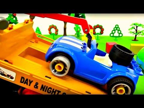 Dessin animé éducatif d'une voiture bleu et une dépanneuse