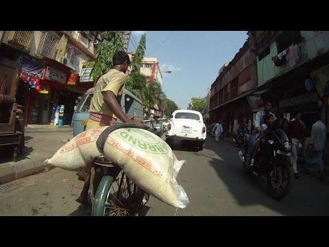 DRIVING THROUGH CALCUTTA (KOLKATA) FIRST PERSON VIEW GOPRO CAMERA. STREETS OF CALCUTTA INDIA.