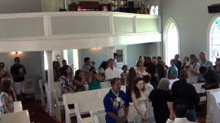 Groom sings bride down the aisle.....SURPRISE!!!!!