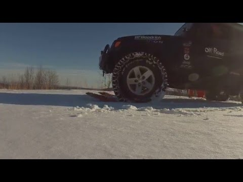 Off Road Consulting Maxtrax test in snow with log