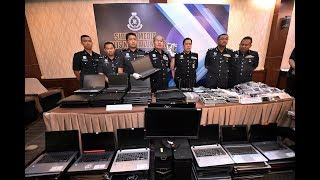 Cops raid gambling den for China clients in KL, 118 detained