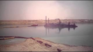 In a scene of drilling and dredging the new Suez Canal March 29, 2015