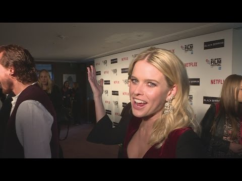 Alice Eve cracks us up as fire alarms go off mid interview!