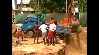 Hitachi helping a truck from falling deep kerala.mp4