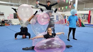 Download GYMNASTICS INSIDE WUBBLE BUBBLE BALL! Mp3 and Videos
