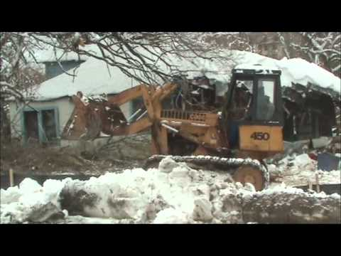 Knocking down old house with case 450 track loader youtube for Old house tracks