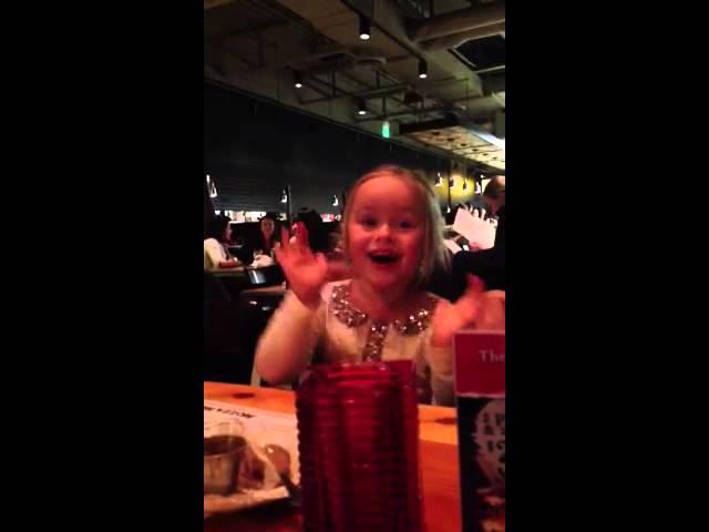 Cute girl sings happy birthday