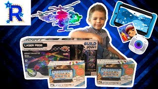 toy opening kids tablet and a Laser pegs light