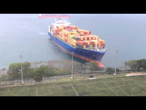 Thumbnail: Container ship sails straight to shore by university football field