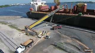 TeleStacker® Conveyor and RazerTail® Truck Unloader Loading Ships in FL