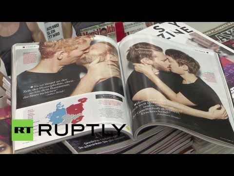 Germany: Straight male celebs smooch for anti-homophobia campaign