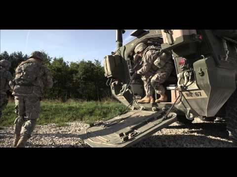 US Army Europe Infantry 2d Cavalry Regiment Germany - Soldiers dismount from Stryker Slow motion