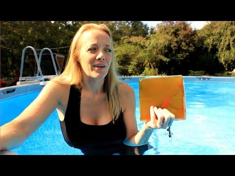 Girl Shooting Pistol Underwater At Ballistics Gel