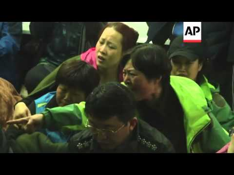 Angry relatives of those still missing following South Korea's ferry disaster surrounded senior offi