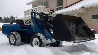Home made wheel loader moving snow
