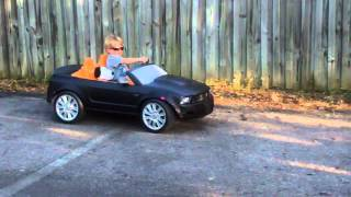 Joseph doing burnouts in his hyped up powerwheels Barbie Mustang
